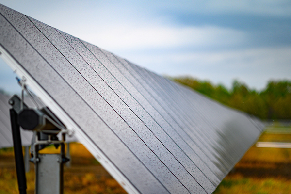 Photo of solar panel in a farm field at St. Joseph Farm in Granger.