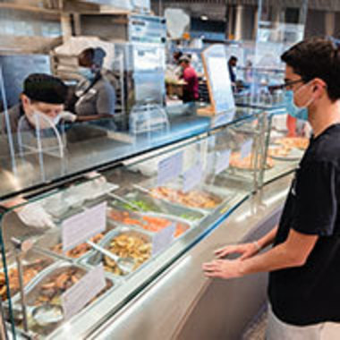 student being served cafeteria-style in North Dining hall