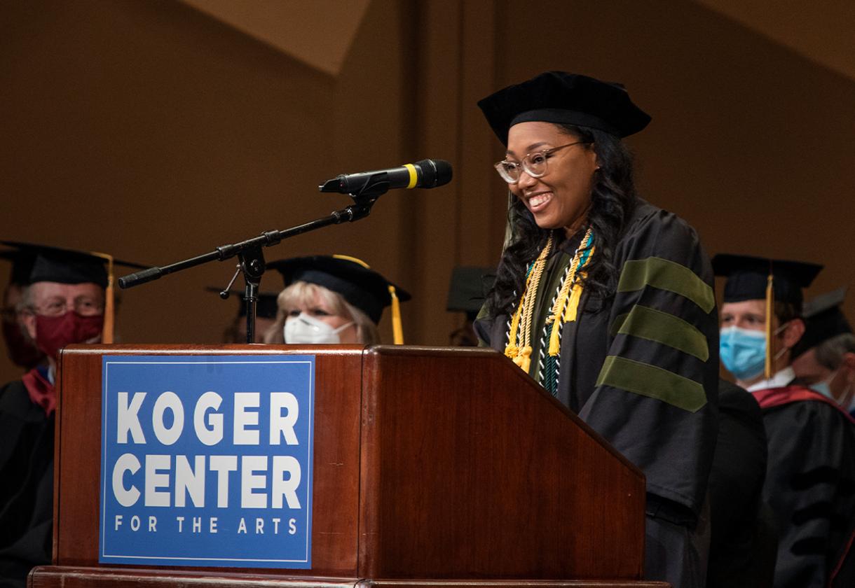 Graduate Courtney Jackson at Convocation podium