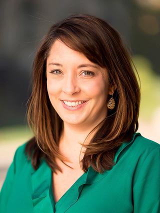 Photo of associate professor Kasey Buckles
