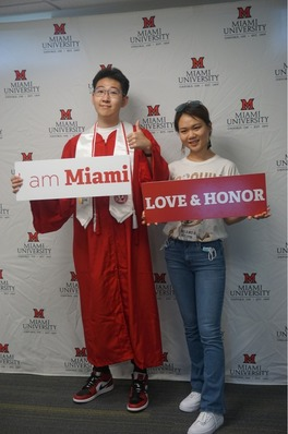 Students holding up I am Miami and Love and Honor signs