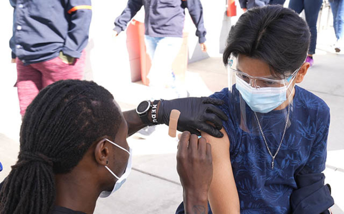 Maquiladora worker in Mexico receiving a COVID-19 vaccine.