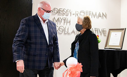 Blane Dessy and Rosaly DeMaios Roffman holding hands during the ribbon cutting in the Dessy-Roffman Myth Collaborative space in the new Leonard Hall