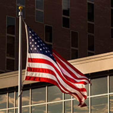 American flag in front of the humanities building