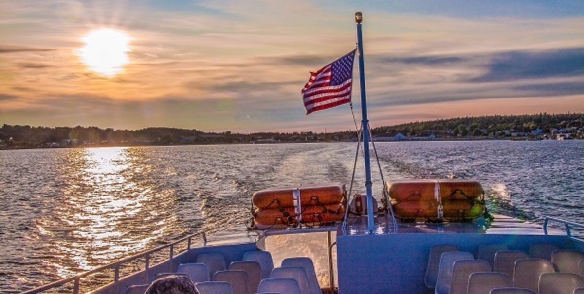 Boat on Mackinac Island in MIchigan at sunset with an American Flag