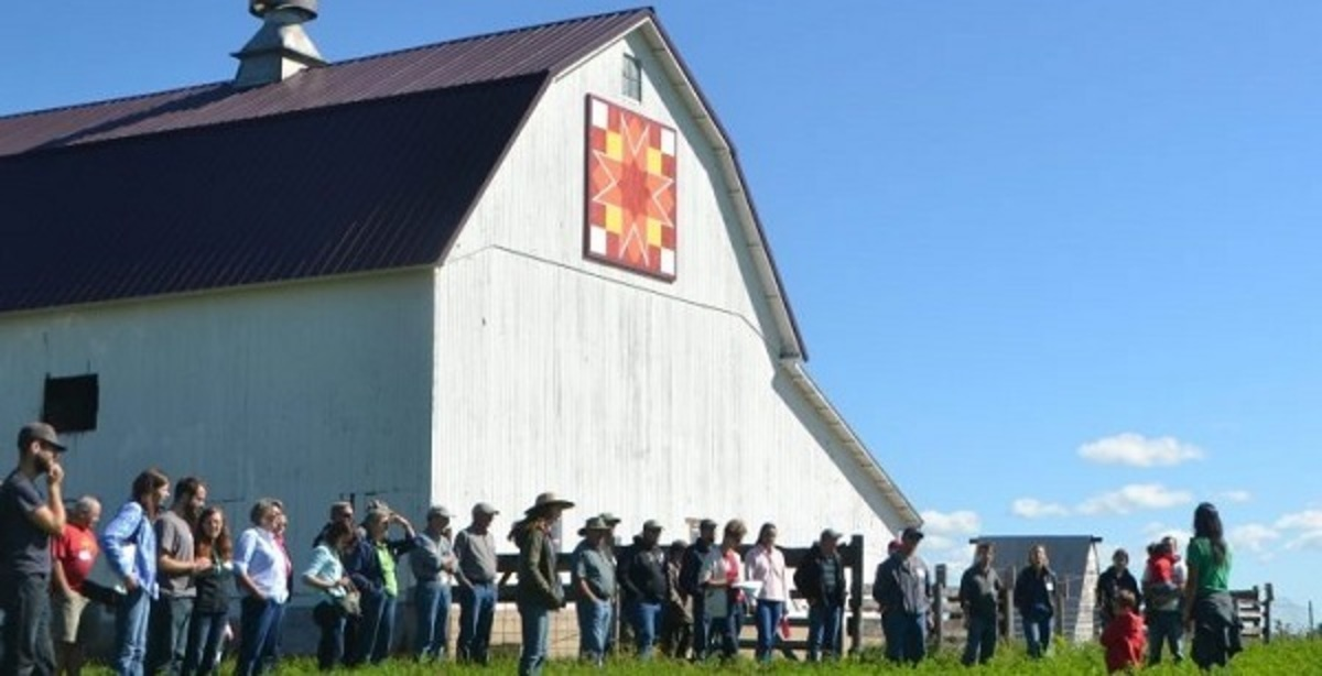 Photo by Wendy Johnson and Practical Farmers of Iowa. People gathered by a barn at a field day