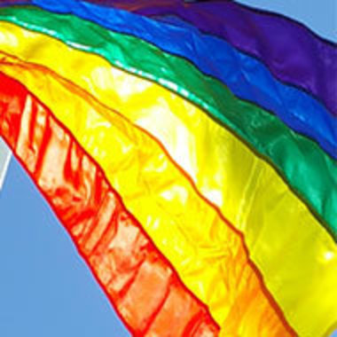 detail of the rainbow flag flying in the sunlight