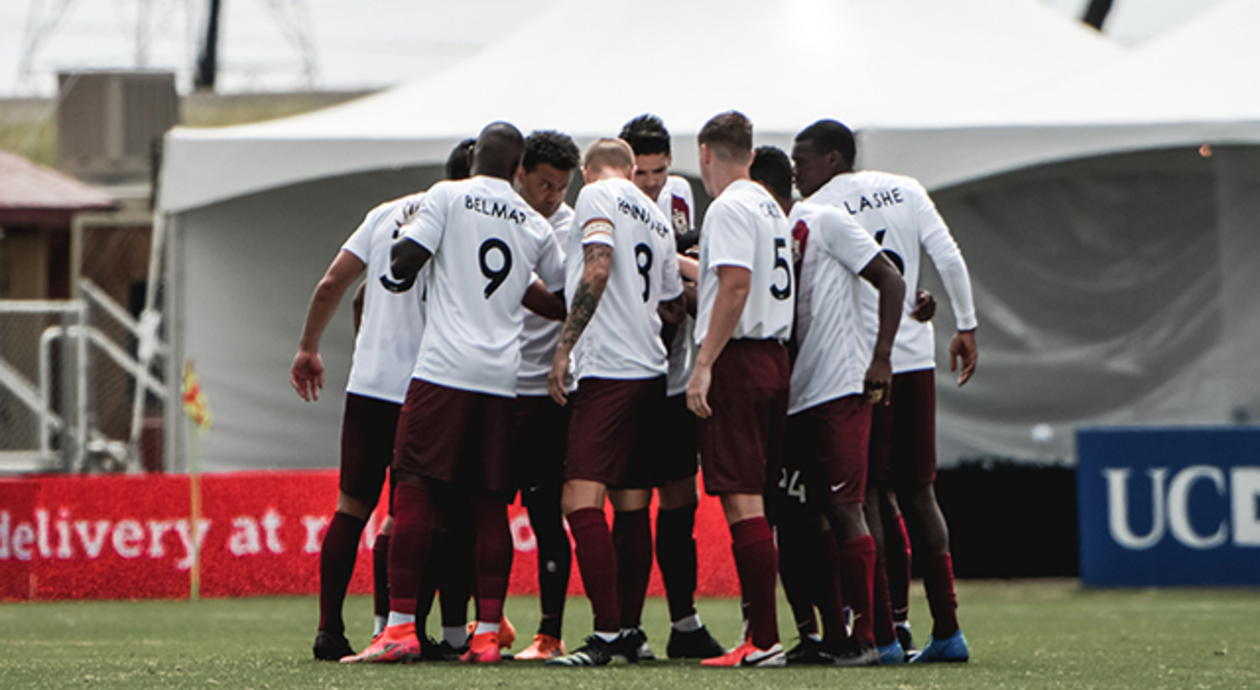 Sacramento Republic FC in a team huddle