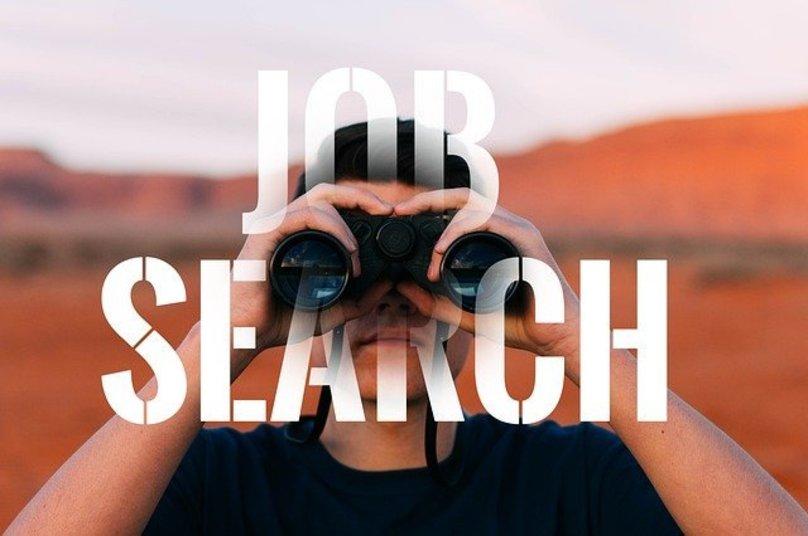 job search man binoculars