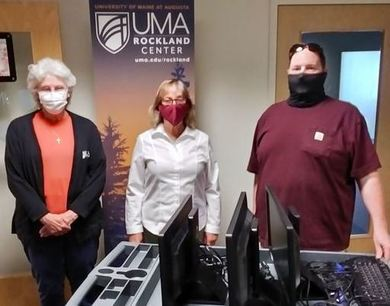 Althea Deb donating computers