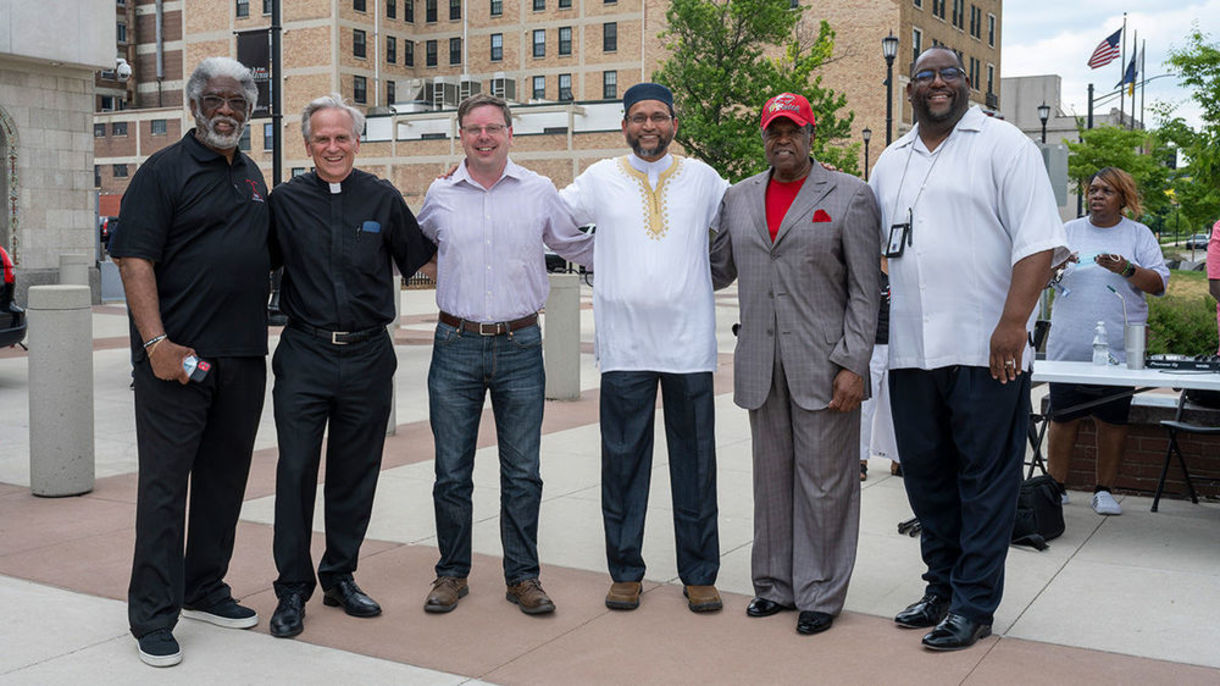Fr. Jenkins poses with faith leaders at prayer service.
