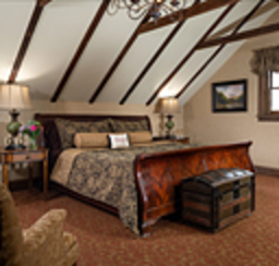 A beautiful B&B bedroom interior with vaulted ceilings.