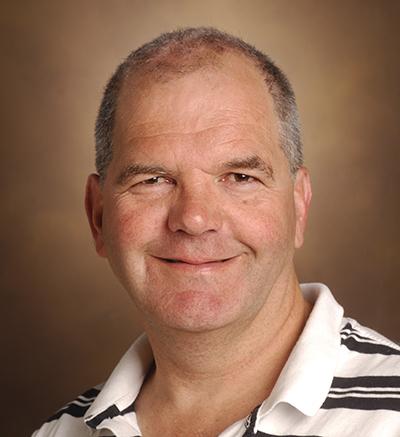 Headshot of Roy Zent.