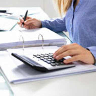 closeup of person using calculator and keeping books