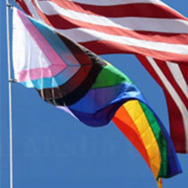 closeup of Progress Pride flag flying with American flag