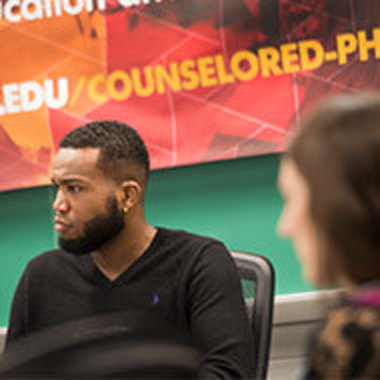 students listen during lecture for Counseling Department PhD program