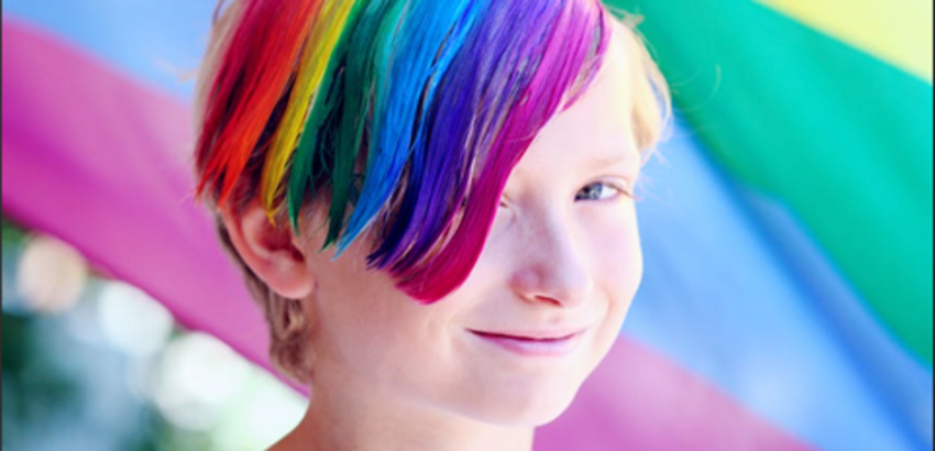 Child with rainbow colored hair, linkto article onbooks and resources to talk about pride month with kids