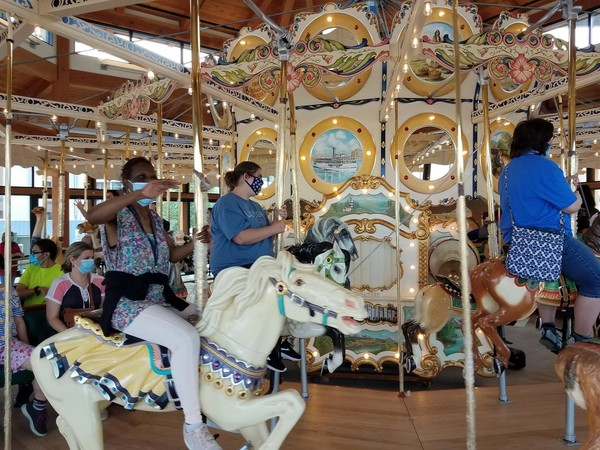 A photo of people riding the carousel at Canalside.