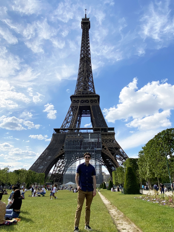 Aidan poses in front of the Eiffel Tower