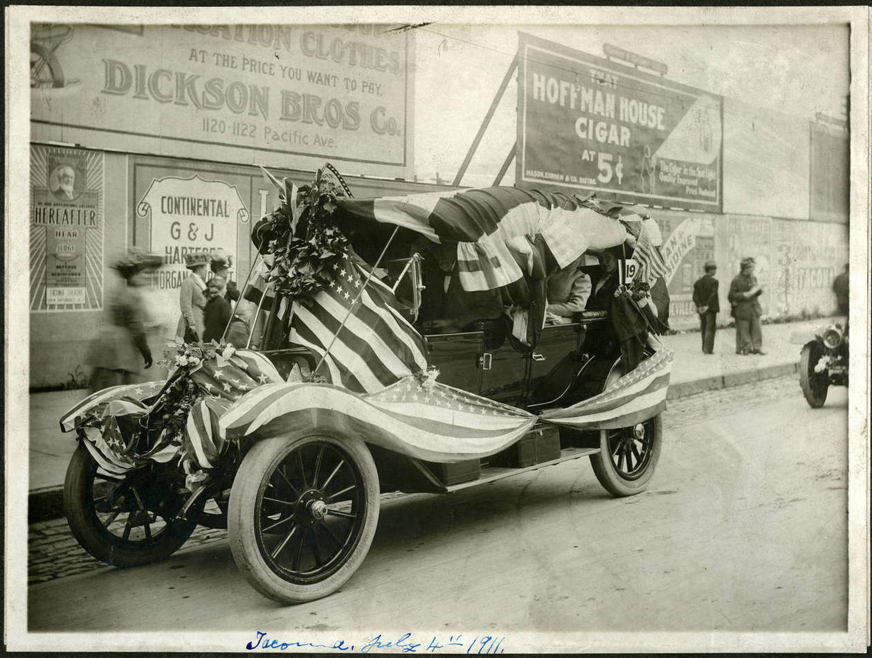 An antique car decked out for the Fourth of July parade, July 4, 1911.