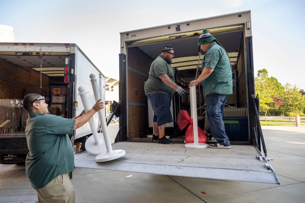 A photo of General Service employees loading items onto a truck.