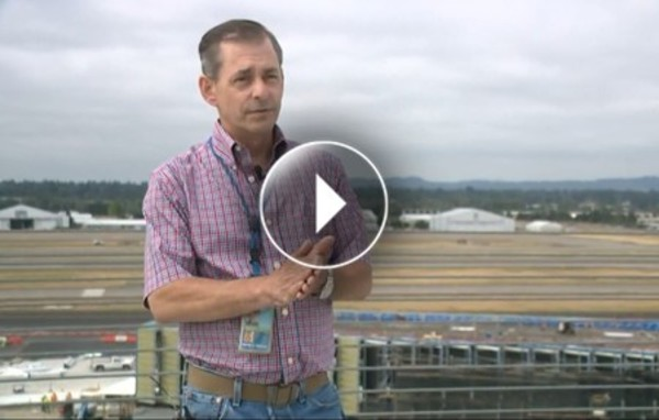 Tom Wharton, an engineer with the Port of Portland being interviewed. PDX runways in the background.
