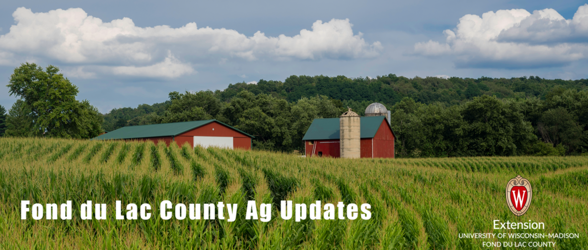 red barn with corn rows,extension logo and text FDL Co Ag Updates