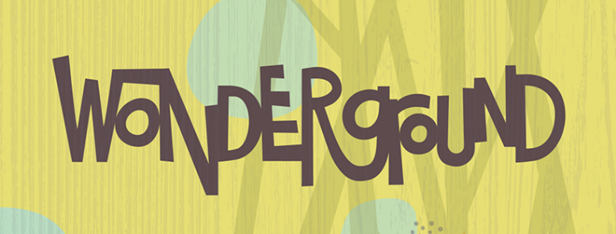 Wonderground logo: Word Wonderground in fanciful type, in natural greens, brown, and teal