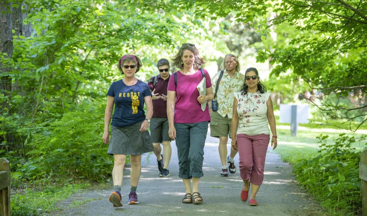 (Front) Annie Coleman, Sarah Nerenberg, Krupali Krusche; (Back) Alex Dowling, Roy Scranton (Photo by Barbara Johnston/University of Notre Dame)