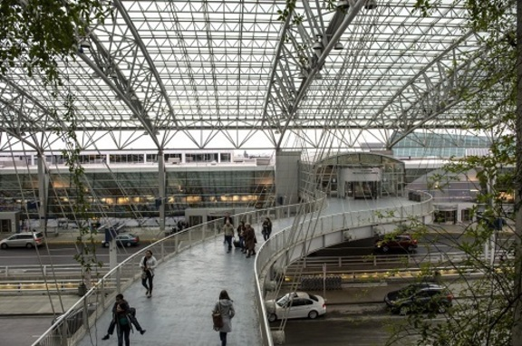 Skybridge from garage to PDX terminal with people walking across it.