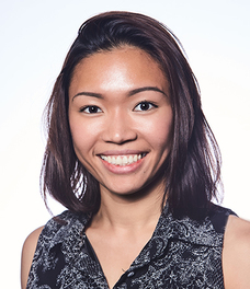 Headshot of Thao Le wearing a black top with a whtie pattern.