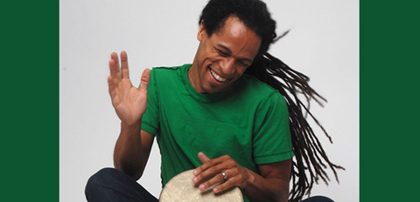 Aaron Nigel Smith playing a bongo, link to registration for music and movement event.