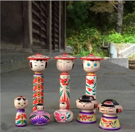 a picture of various kokeshi wooden dolls