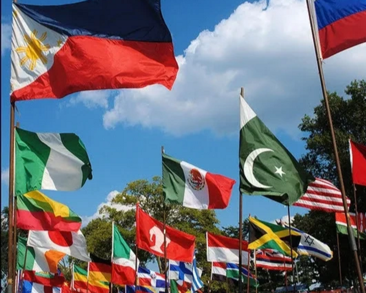Image of flags from multiple countries swaying in the wind