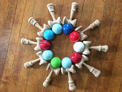 kendama posed together to form a circle