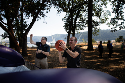 Pilots Together Again employees playing basketball