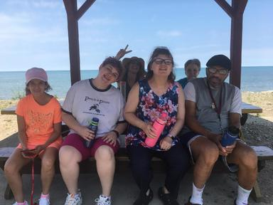 A photo of Housemates from one of our group homes in at the beach.