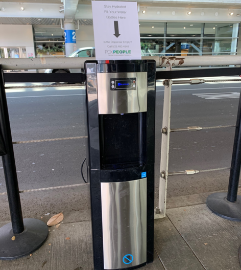 Water dispenser on the roadway at PDX.
