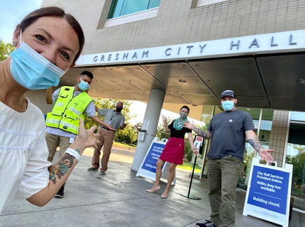 Sasha Konell takes a selife in front of City Hall with City Manager Nina Vetter.