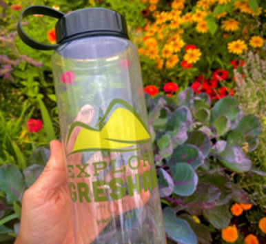 A water bottle with the Explore Gresham logo