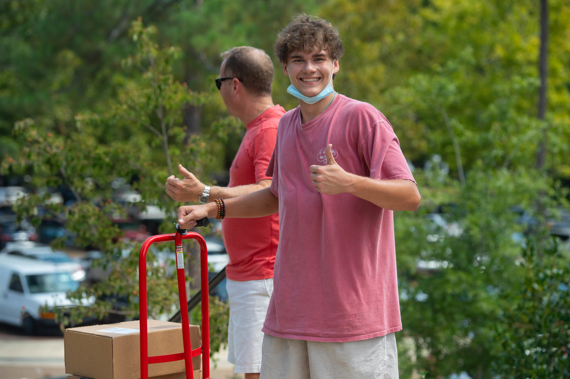 Student moving in with thumbs up
