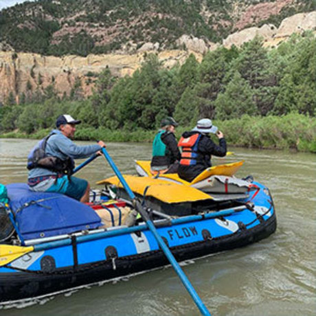 Bruce Saxman, manager of the FLOW program, rows a raft on the Chama River