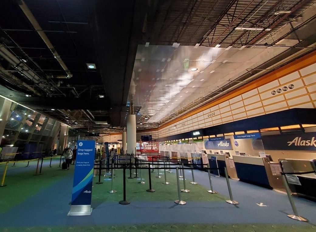 PDX ticket lobby with clear protective panels on the ceiling.