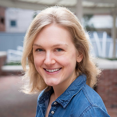 Headshot of Carolyn Roe wearing blue denim shirt.