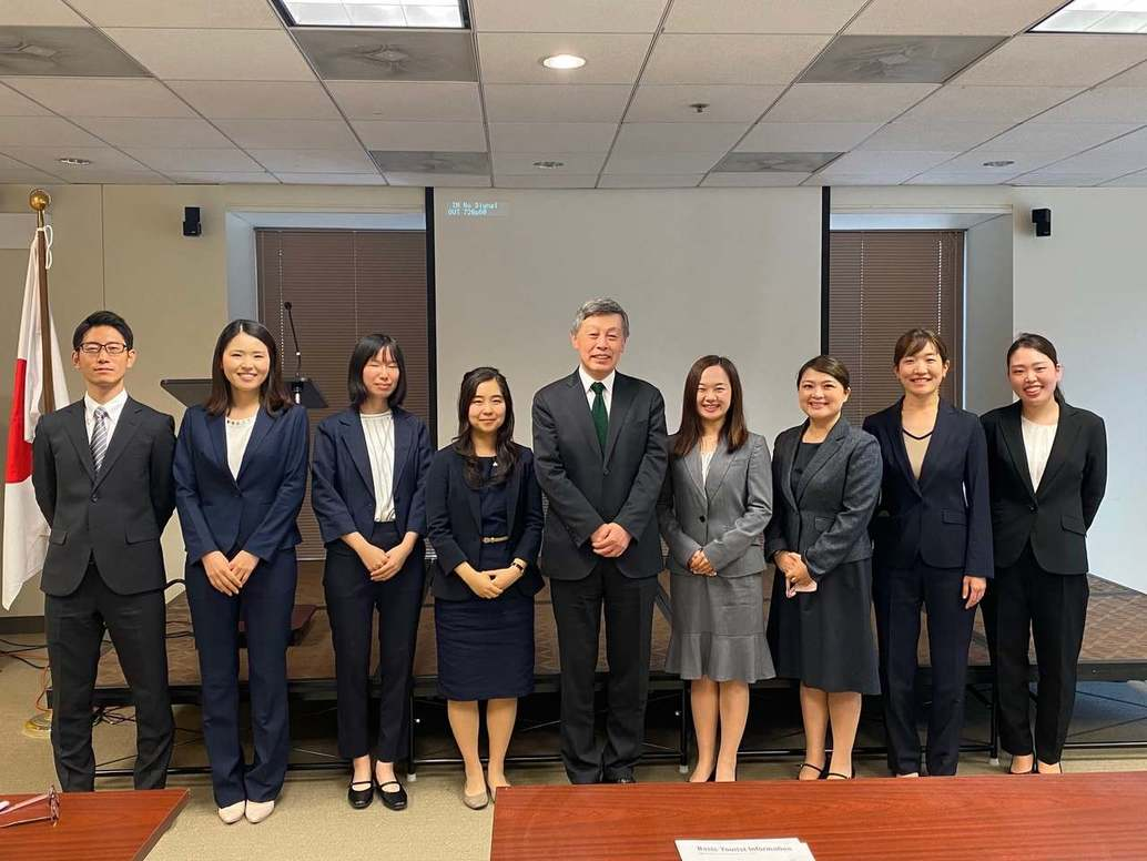 CG Okada (center) standing with the eight JOI Coordinators from Japan at the JIC