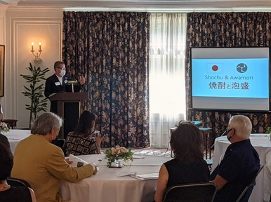 Stephen Lyman giving a presentation about Shochu in the Official Residence