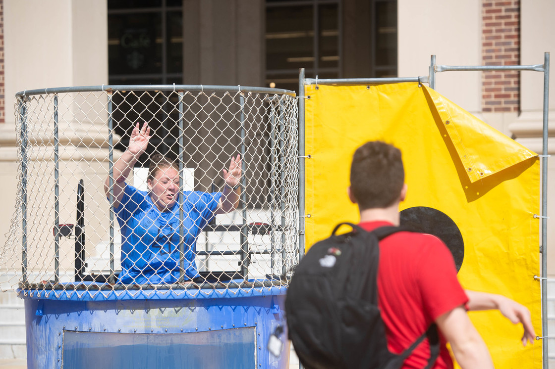 Student being dunked in a dunk tank