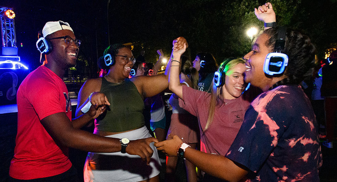 Students dancing wearing headphones at a silent disco