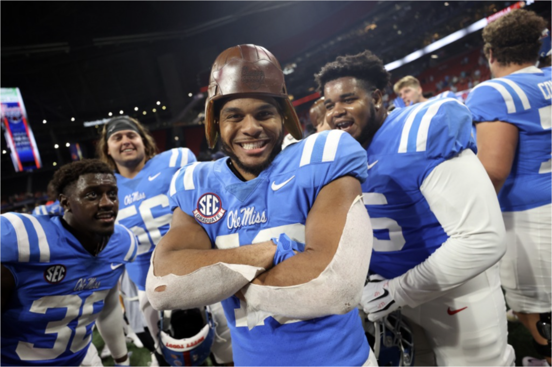 Ole Miss Football vs Louisville in the 2021 Chick-Fil-A Kickoff in Atlanta, GA. Players smiling into the camera post game