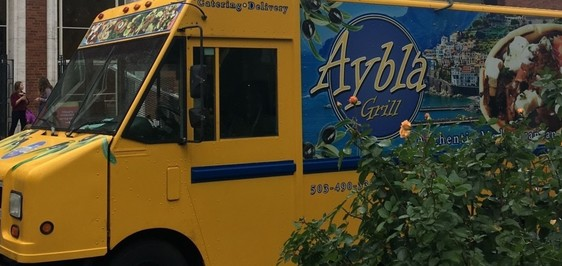 The Aybla Grill food truck, parked by a rose bush.